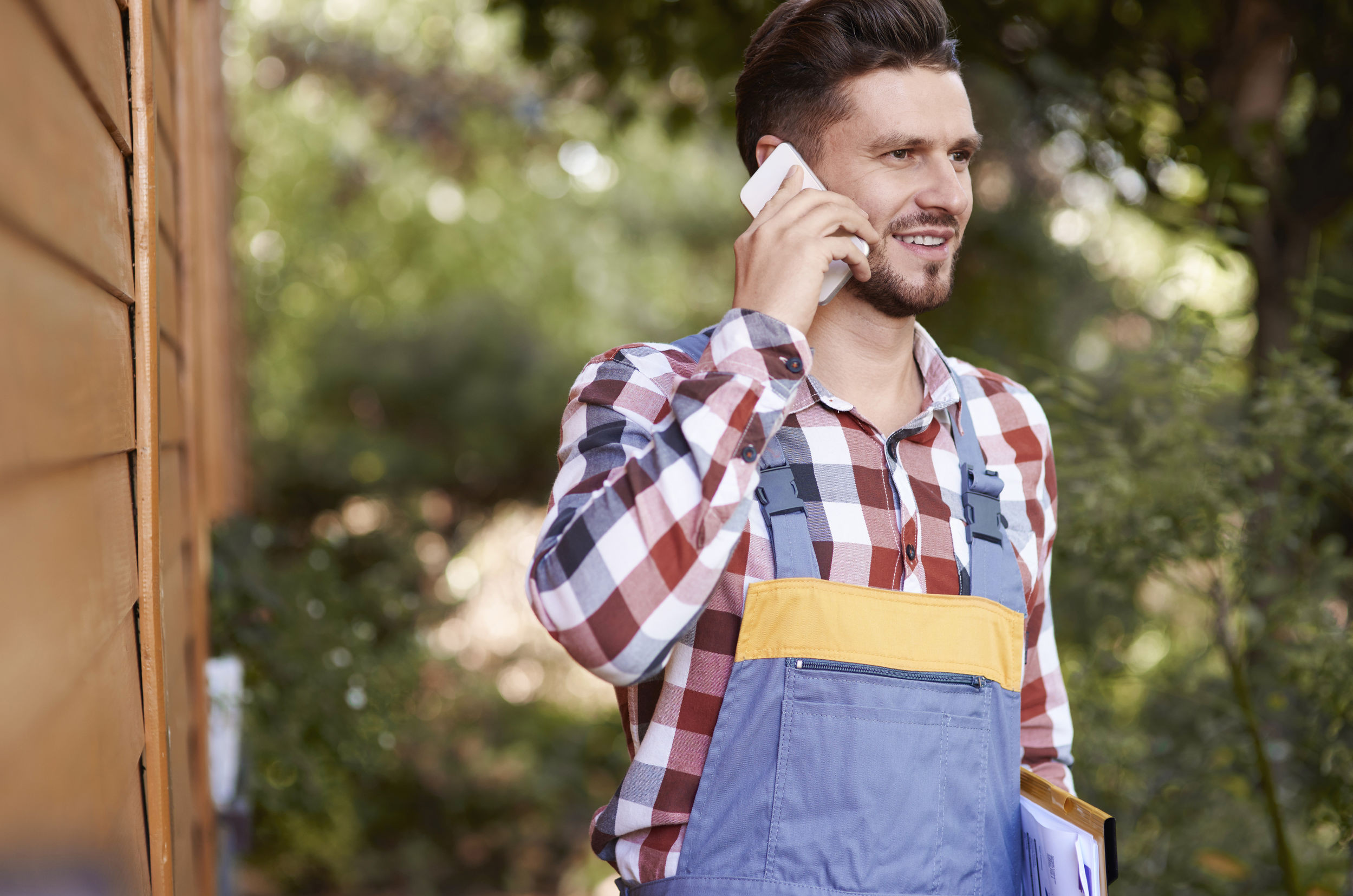worker on phone buying used equipment
